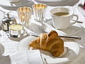 Breakfast setting with croissant