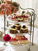 Small cakes and petit fours on tiered stand