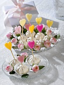 Meringues with coloured heart-shaped candles