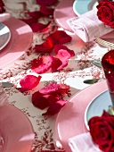 Red rose petals (table decoration)