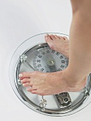 Woman on scales (feet)