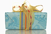 Gift tied with coloured ribbon