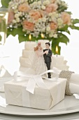 Wedding place-setting with gift and bride & groom figures