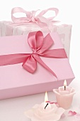 Two gifts and flower candles