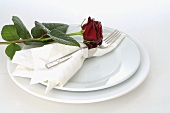 Elegant place-setting with red rose