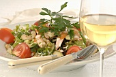Seafood salad and glass of white wine