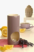 Aroma lamp with lavender & lemon, cup of tea, Buddha head