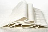 Folded white fabric napkin