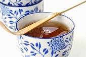 Bowl of tea with bamboo spoon