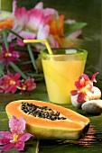 Half a papaya and a glass of fruit juice