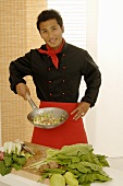 Asian chef with wok frying pan
