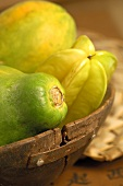 Exotic fruit in wooden bowl