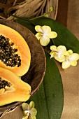 Papaya, halved, in wooden bowl