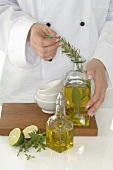Female chef making herb oil