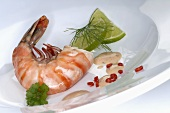 Prawn with lime slices, dill sauce and chilli rings