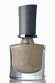 Beige nail varnish in bottle
