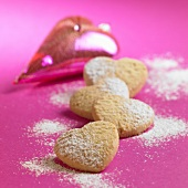 Almond hearts sprinkled with icing sugar for Christmas