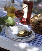 Mediterranean appetiser: olives, bread, rosé wine