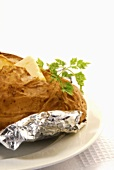A baked potato with butter and chervil