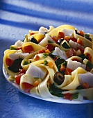 Ribbon pasta with fish and vegetables