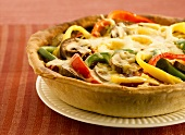Pepper and mushroom tart with melted cheese topping