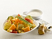 Mixed fruit and vegetable salad, gingered yoghurt dressing