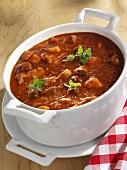 Goulash soup in a ceramic pot