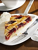 A piece of Linzer torte with whipped cream