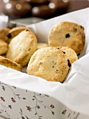 Raisin scones in a biscuit tin
