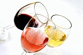 Glasses of French red, white and rosé wine (one of each)
