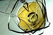 Broken wine glass with white wine
