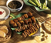 Beef and lamb satay with various dips