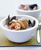 Two bowls of seafood soup