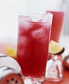 Red fruit cocktail with ice