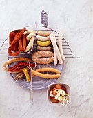 A selection of raw and grilled sausages