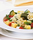 Vegetable stew with spaghetti and pesto