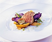 Veal fillet on vegetables with truffle potato crisps