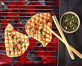 Tuna on a barbecue with coriander and chilli dip