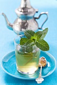 Glass of peppermint tea with fresh mint