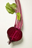 Beetroot with leaves, halved