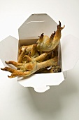 Deep-fried chicken feet to take away (Asian snack)