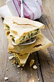 Spinach and ricotta pie (one piece on spatula)