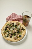 Pizza with tuna, chard and olives, glass of cola