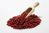 Red peppercorns with wooden scoop