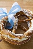 Two salted pretzels with blue and white bow (Bavaria)