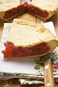 Cherry pie, a slice cut, with slice on fabric napkin