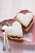 Heart-shaped cakes with jam and icing sugar