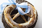 Two salted pretzels with blue and white bow