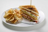 Club sandwiches, toasted, with crisps
