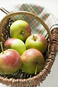 Five fresh apples in basket